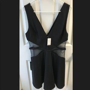 Bebe black and shear size large dress